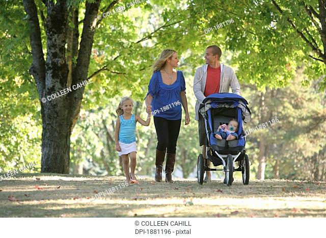 a family walking together in a park, gresham, oregon, united states of america