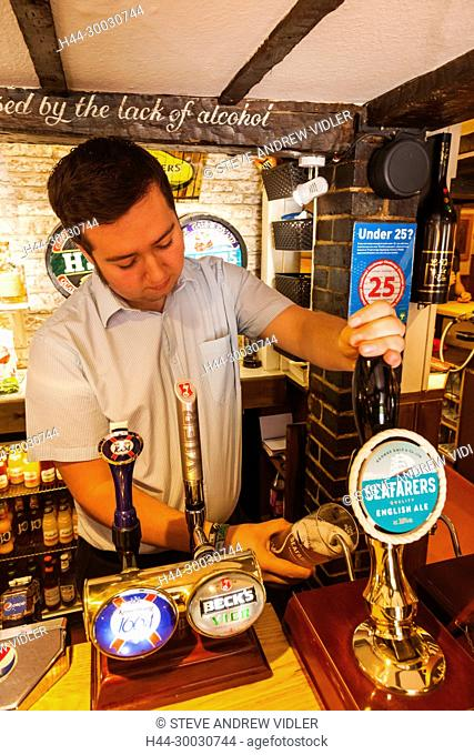 England, Hampshire, Stockbridge, The Mayfly Pub, Barman Pouring Beer