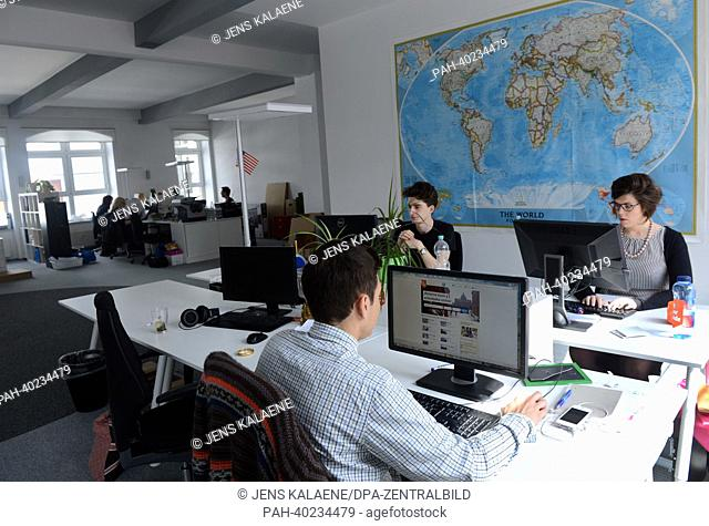 Staff of online start-up booking plattform 'GetYourGuide',are busy working at their workstations in the headquarter of his company in the Erich-Weinert-Strasse...