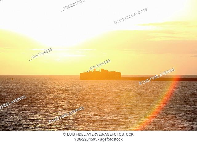 Sunset at the output of the industrial port of Cherbourg in France