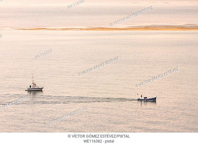Two fishing boats in Santander's bay at sunshine, Cantabria, Spain