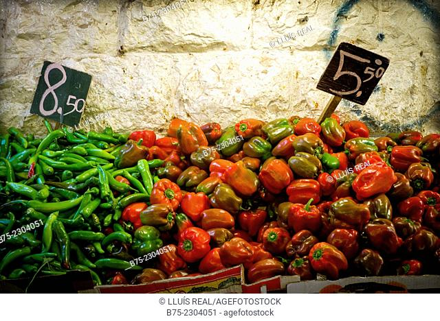 Closeup of red peppers and green chilli peppers with the price 8, 50 - 5, 50 in a market in Jerusalem, Israel, Middle East