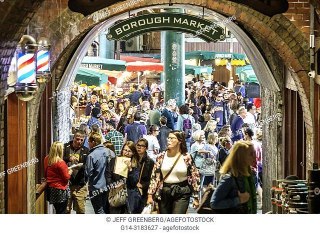 England, London, South Bank Southwark, Borough Market, vendors stalls, entrance, crowded, woman, man