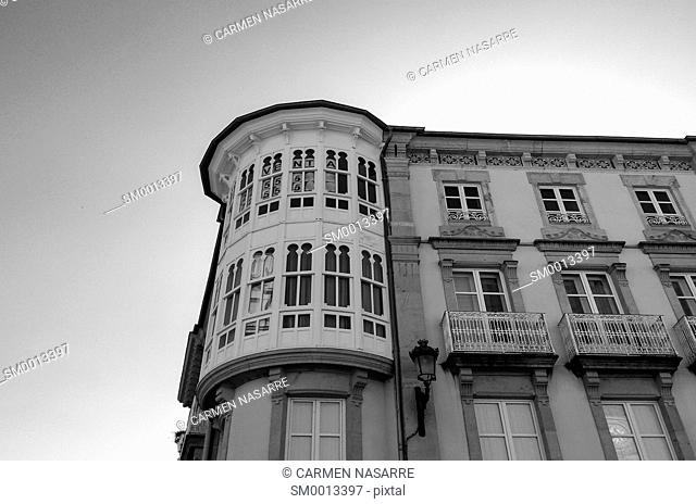 Facade of old building with balconies and windows
