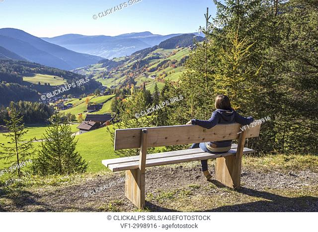 A girl looking at the valley, Puez Odle Natural Park, South Tyrol, Italy