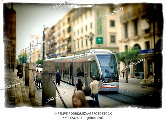 Pedestrians and streetcar on Constitution Avenue, Seville, Spain  Taken with tilted lens to get shallower depth of field and digitally edited to look like an...