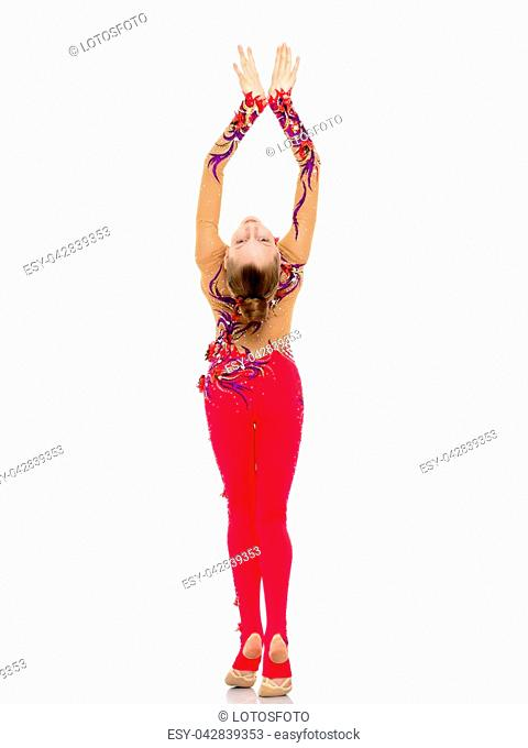 Beautiful little girl is having fun dancing in the studio on a white background. The concept of a school of dance, happy people. Isolated