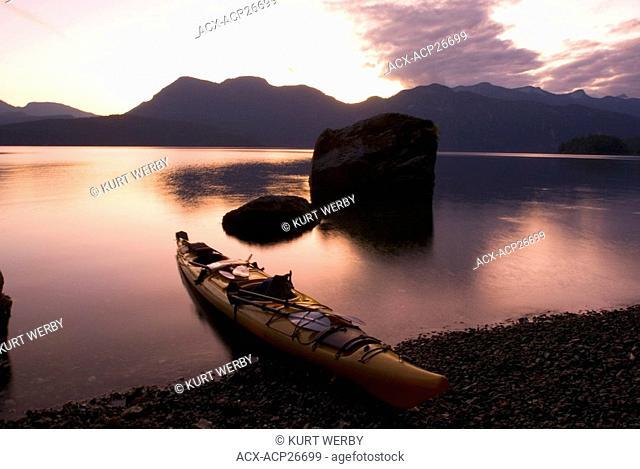 The sun sets over Hotham Sound along the British Columbia coast Canada