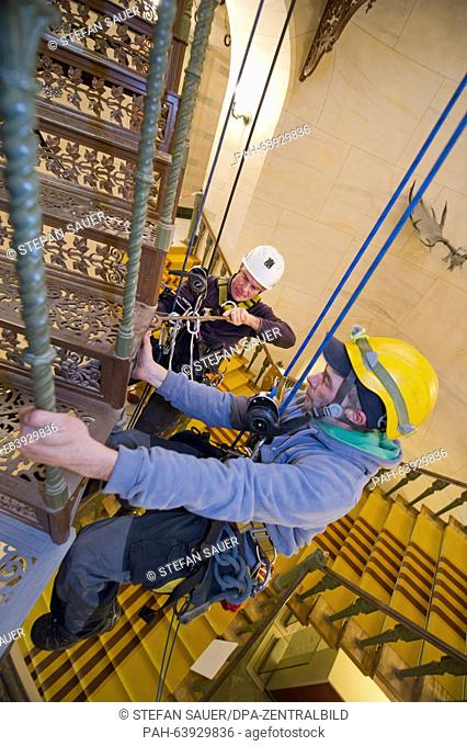 Rope access technicians Mike Simon and Kai Simon (L-R) from the company Skyworx-Seiltechnik Berlin remove a step from the circular staircase in the tower of the...