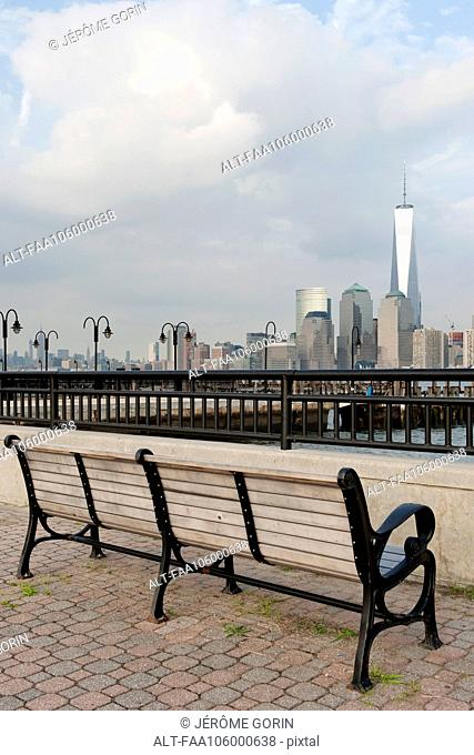 Park bench with scenic view of Lower Manhattan, New York City, New York, USA