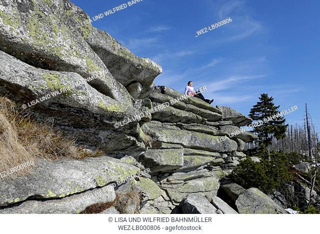 Germany, Bavaria, Lower Bavaria, Bavarian Forest, Dreisessel area, Hiker resting at the Ploeckenstein