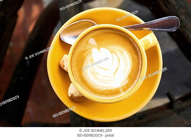 Overhead view of latte in cup and saucer, Antigua, Guatemala