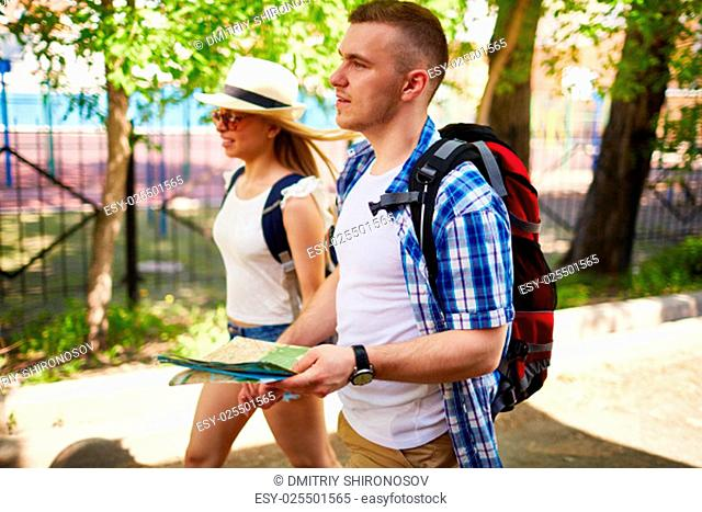 Affectionate tourists chilling out in foreign city