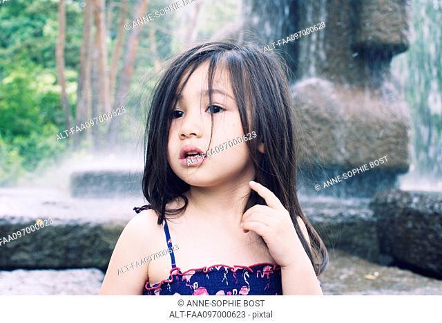 Little girl by water fountain, portrait