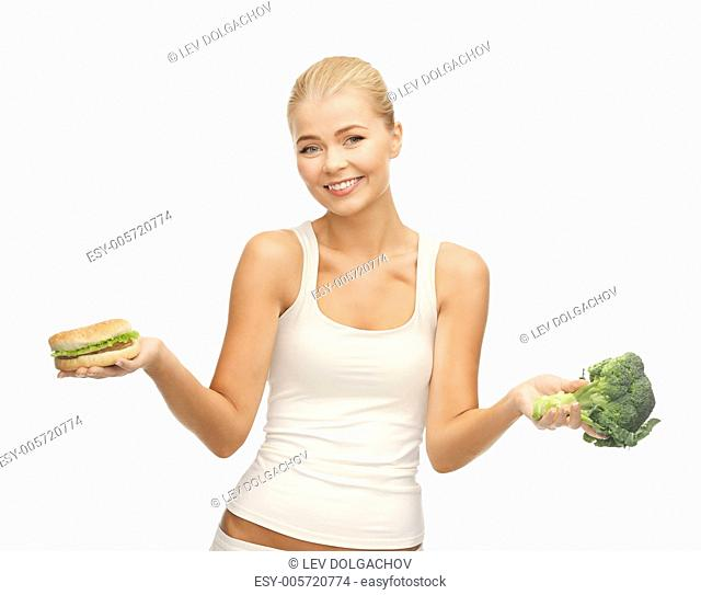 picture of sporty woman with broccoli and hamburger