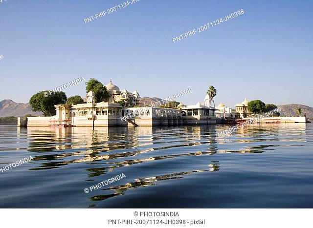 Temple with a mosque in a lake, Lake Pichola, Udaipur, Rajasthan, India