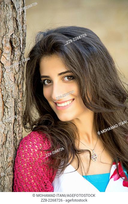 Beautiful young woman smiling outdoors