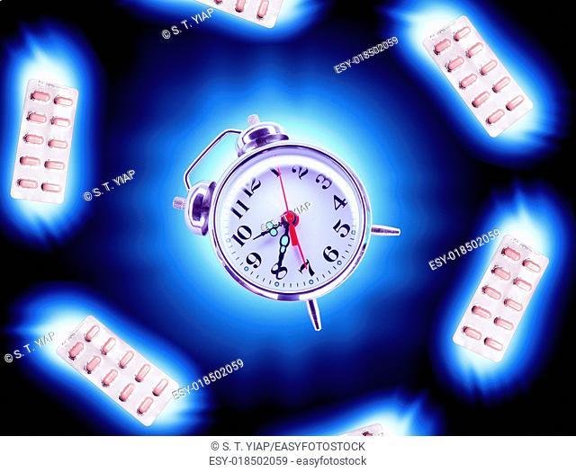 Pills around Alarm Clock