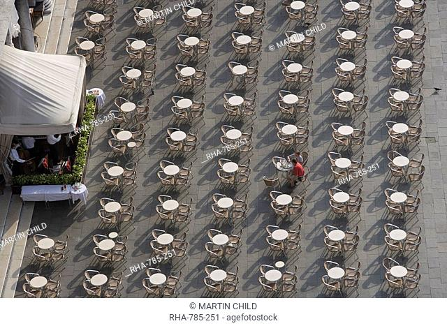 View from Campanile of two diners and musicians at Open Air Cafe, St. Mark's Square, Venice, Veneto, Italy, Europe