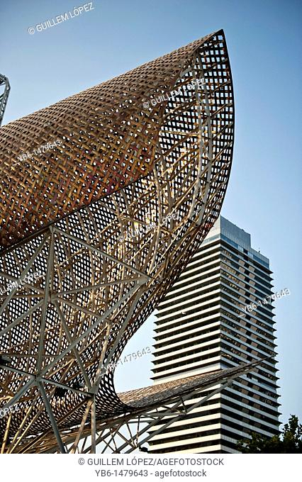 Fish Sculpture with the Mapfre tower of Barcelona, Spain