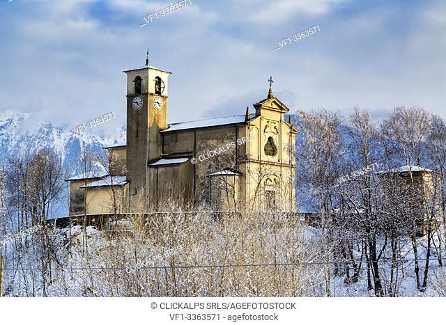 Old church of Sant'Andrea surrounded by snow, Civo, Costiera dei Cech, Sondrio province, Valtellina, Lombardy, Italy