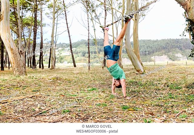 Man doing suspension traning outdoors