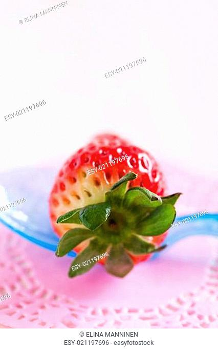 Fresh whole strawberry and spoon