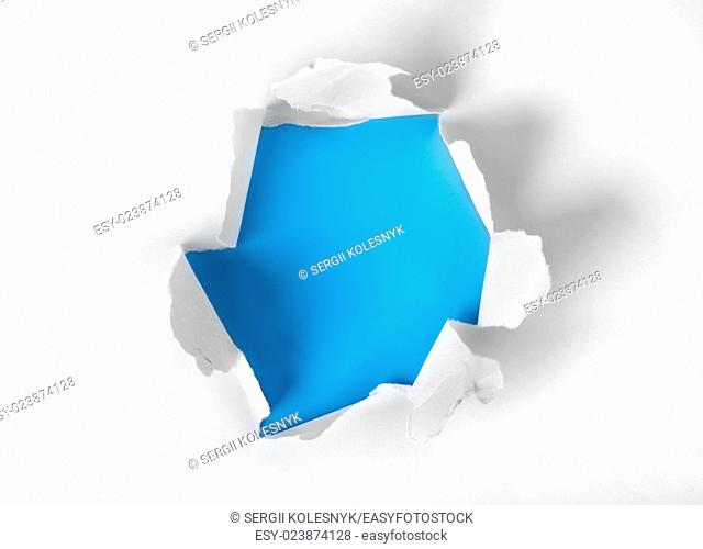 White paper torn with blue background
