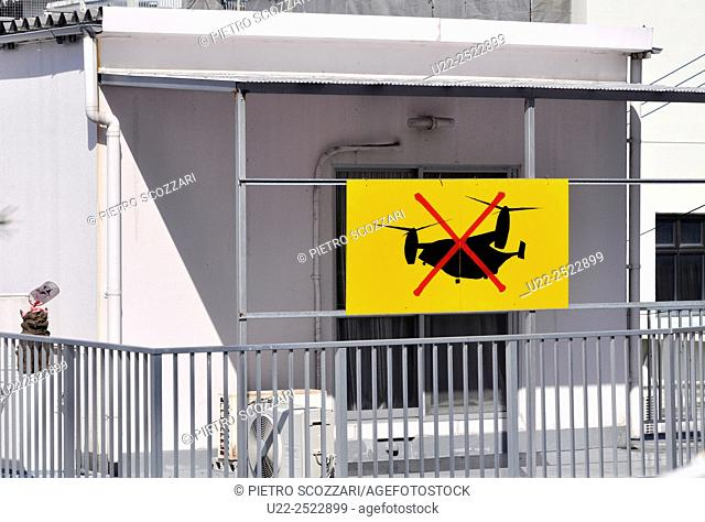 Naha, Okinawa, Japan: a house with a sign against American V-22 Osprey helicopters