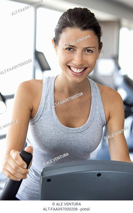 Woman exercising in health club, portrait