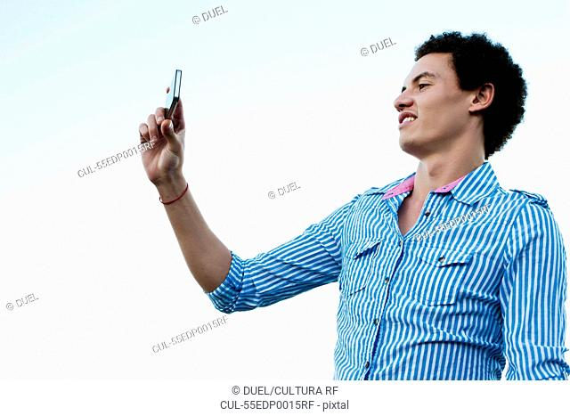 Young man taking a picture of himself
