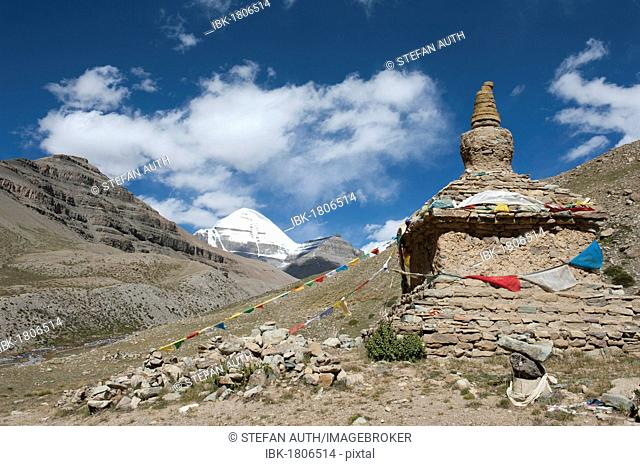 Tibetan Buddhism, ancient stupa, snow-covered holy Mount Kailash, Gang Rinpoche mountain, south face with cleft, pilgrims' path near Selung Gompa monastery