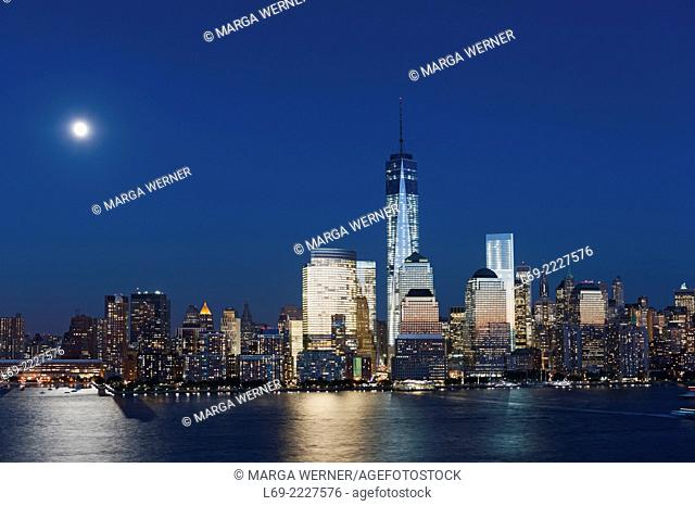 Full moon over Manhattan skyline, One World Trade Center, World Financial Center at Hudson River, New York, USA