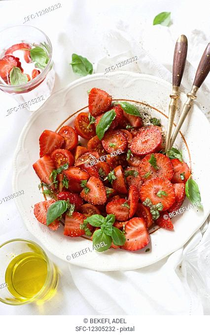 A strawberry salad with olive oil, balsamic and basil