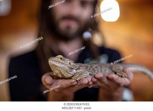 Man holding a bearded dragon