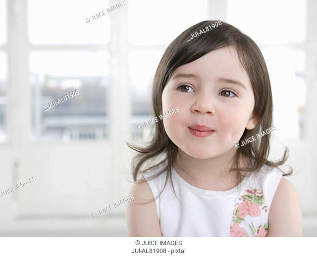 Young girl smiling indoors