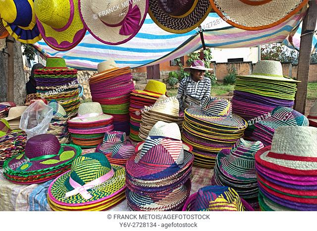 Woman selling traditional hats during the weekly market. At Ambositra ( Madagascar)