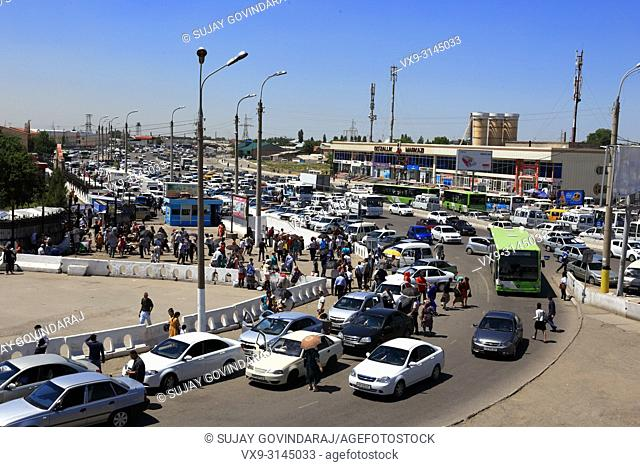 Tashkent, Uzbekistan - May 12, 2017: View of traffic and huge crowd at Kuilyuk Bazaar market area, one of the most busiest commercial place in the city