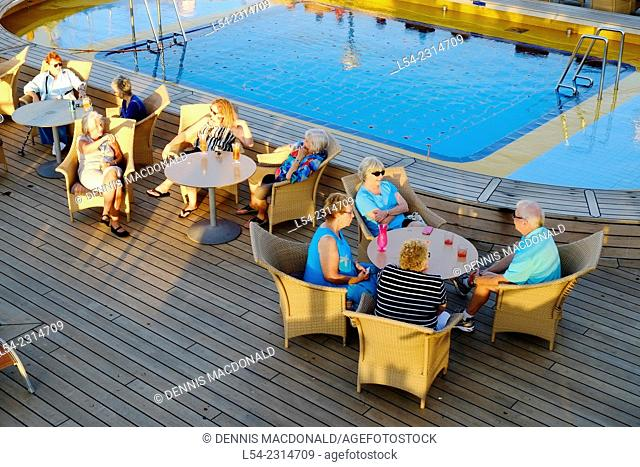 Senior couples relax on the deck of a cruise ship