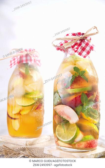 bottle of infused fruit tea with peach and lemon