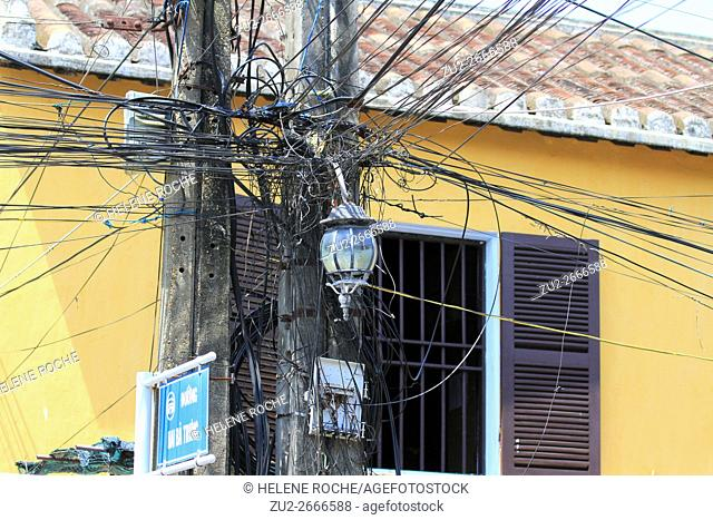 Messy electrical cable pole, Hoi An old town, Vietnam, Asia