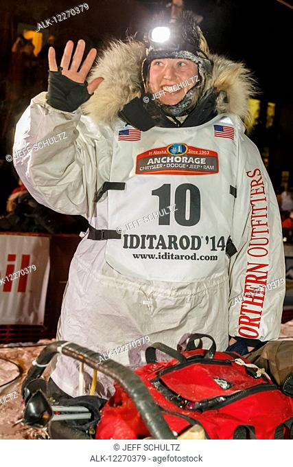 Aliy Zirkle waves to the crowd shorlty after finishing in second place during the Iditarod Sled Dog Race 2014