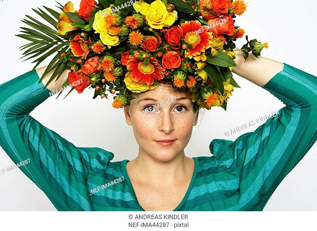 A woman with lots of flowers in her hair