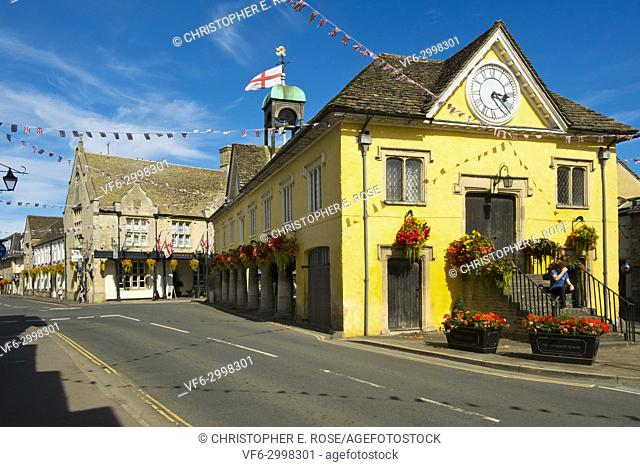 Summer sunshine brings a few people to Tetbury on a quiet afternoon, Gloucestershire, Cotswolds, UK