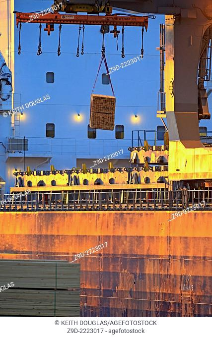 Freighter being loaded with lumber, Duke Point wharf, Nanaimo, Vancouver Island, British Columbia
