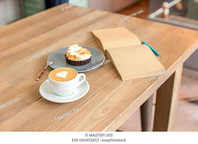 A table setting on the counter at a coffee house. Barista, cafe, making coffee, preparation and service concept. . The hipster stile