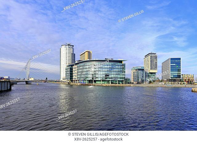 The new footbridge leading to the BBC buildings, ITV buildings and the Heart residential building at MediaCityUK, Salford Quays, Manchester, Lancashire, England