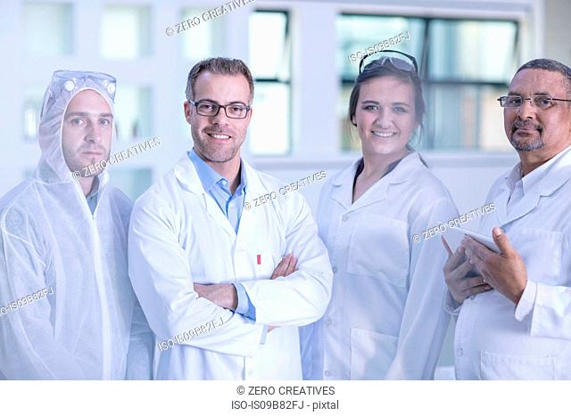 Portrait of four laboratory workers in lab