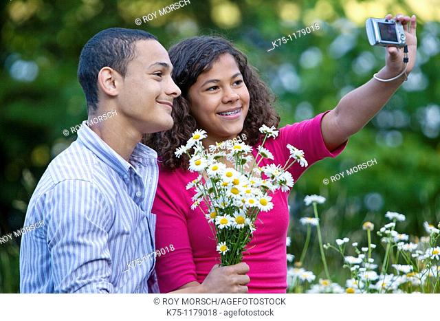 Teen couple pose for self portrait