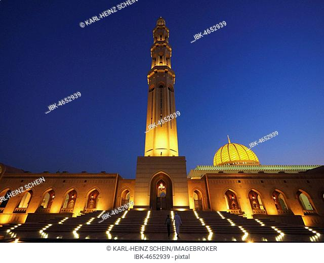Evening atmosphere, illuminated Great Sultan Qabus Mosque with minaret, Muscat, Oman